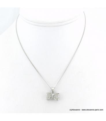 Collier pendentif noeud papillon métal et strass argenté