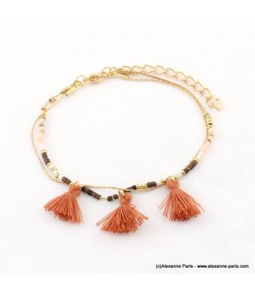 Bracelet avec perles rocaille et pompons Lina marron