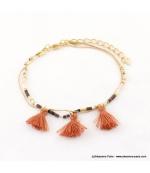 Bracelet avec perles rocaille et pompons Lina