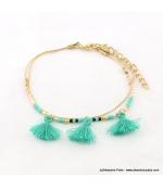 Bracelet avec perles rocaille et pompons Lina turquoise